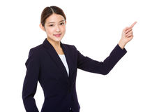 Businesswoman with finger pointing something out Royalty Free Stock Image