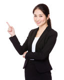 Businesswoman finger pointing up for selling something Stock Photography
