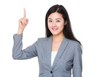 Businesswoman with finger showing up Stock Photos