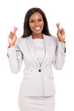 Businesswoman fingers crossed. Beautiful african american businesswoman with fingers crossed Stock Photos