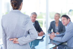 Businesswoman with fingers crossed behind her back Royalty Free Stock Images