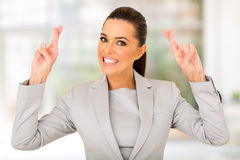Businesswoman fingers crossed Royalty Free Stock Photo