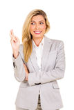 Businesswoman with fingers crossed Stock Photo