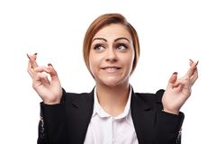 Businesswoman with fingers crossed Royalty Free Stock Photos