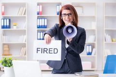 The businesswoman firing people in office Stock Photography