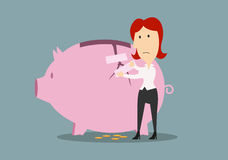 Businesswoman fixing the crack on piggy bank. Money savings and financial safety concept. Frustrated redhead businesswoman fixing the crack on the side of piggy Stock Images