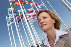 Businesswoman with flags. Stock Photo