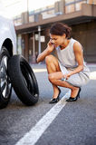 Businesswoman flat tire Stock Images