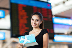 Businesswoman flight information Stock Photo