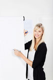 Businesswoman with a flip chart Royalty Free Stock Photo