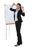 Businesswoman with a flipchart Royalty Free Stock Image