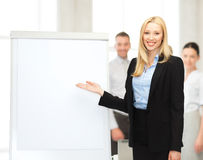 Businesswoman with flipchart in office Stock Image