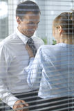 Businesswoman flirting with his colleague in office Royalty Free Stock Photos