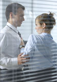Businesswoman flirting with his colleague in office Stock Image