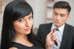 Businesswoman flirting and pulling her colleague Stock Images