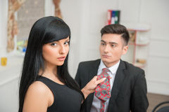 Businesswoman flirting and pulling her colleague Stock Image