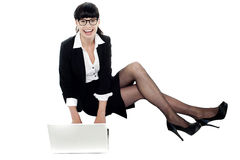 Businesswoman on floor preparing a presentation Royalty Free Stock Image
