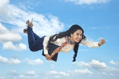 Businesswoman flying in air Stock Photos