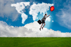 The businesswoman flying balloons on bright day Royalty Free Stock Photos