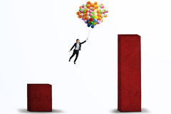 Businesswoman flying with balloons isolated Stock Photography