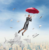 Businesswoman is flying over downtown Royalty Free Stock Photo