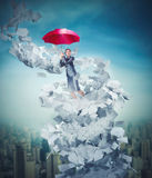 Businesswoman is flying over downtown Stock Photo
