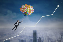 Businesswoman flying over upward arrow Stock Image