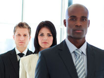 Businesswoman in focus with her team in a line Stock Images