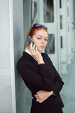 Businesswoman focused on mobile conversation Stock Images
