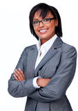 Businesswoman with folded arms wearing glasses Stock Images