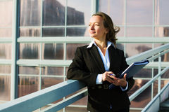 Businesswoman with a folder. Royalty Free Stock Images