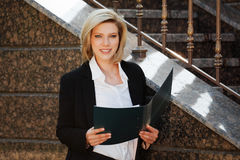 Businesswoman with a folder Royalty Free Stock Photography