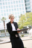 Businesswoman with folder Stock Photo