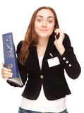 Businesswoman with folder calling by phone Stock Photography