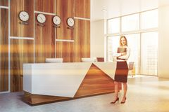 Businesswoman with folder near office reception royalty free stock image