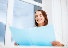 Businesswoman with folder in office Royalty Free Stock Photos