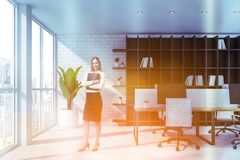Businesswoman with folder in white office royalty free stock photography