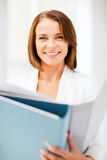Businesswoman with folders in office Stock Photography