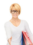 Businesswoman with folders ready for handshake Royalty Free Stock Image