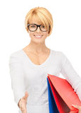 Businesswoman with folders ready for handshake Stock Photo