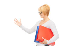 Businesswoman with folders ready for handshake Royalty Free Stock Images