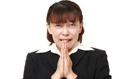 businesswoman folding her hands in prayer Stock Images