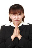 Businesswoman folding her hands in prayer Stock Image