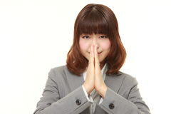Businesswoman folding her hands in prayer Royalty Free Stock Images