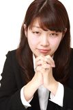 Businesswoman folding her hands in prayer Royalty Free Stock Photo