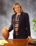 Businesswoman with football. Businesswoman at desk with football royalty free stock images