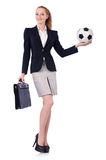Businesswoman with football Stock Images