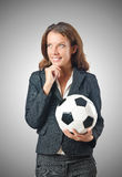 Businesswoman with football on white Royalty Free Stock Photography