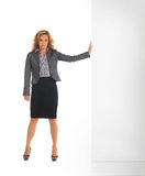 A businesswoman in formal clothes behind a wall Royalty Free Stock Photo