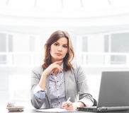 A businesswoman in formal clothes in an office Stock Photo